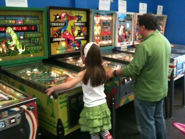 Seattle Pinball Museum Dad and daughter