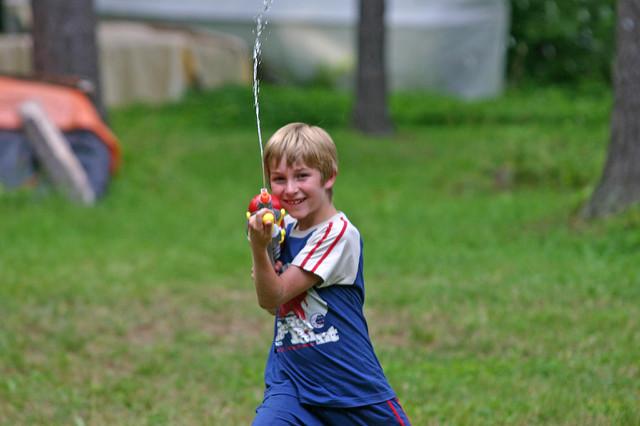 Boy with squirt gun Dan Zen on flickr CC