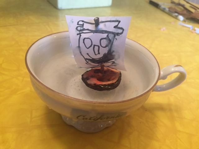 walnut boat in teacup