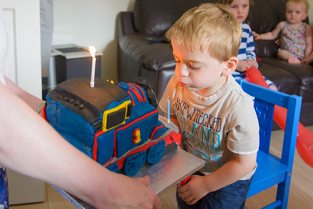 blowing-out-candles-thomas-cake